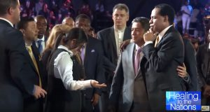 Pastor Rebecca Osorno at a healing service with Pastor Chris