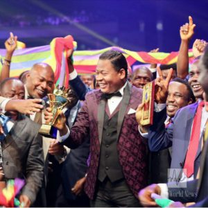 Pastor Tom Amenkhienan receives Loveworld awards from Pastor Chris