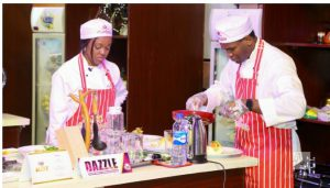 The CMD and wife of the CMD (WCMD) concentrate on their dish for the President.