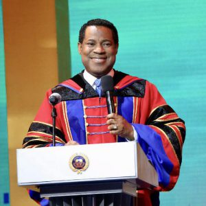Pastor Chris ministers to the crowd at final service